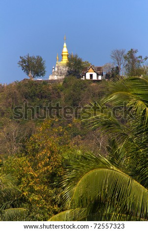 Buddhist Hilltop Temple of Phu Si in Luang Prabang, Popular Tourist Destination in Laos, Southeast Asia - stock photo
