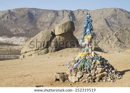 Buddhist holy place - obo, against the backdrop of a stone turtle - stock photo