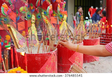 Buddhist is burning incense in Chinese temple - stock photo