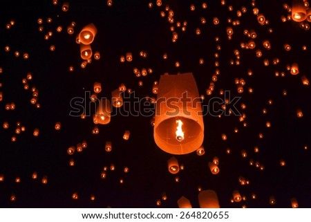 Buddhist Loy Krathong and Yi Peng Festival at full moon in Chiang Mai, Thailand - stock photo