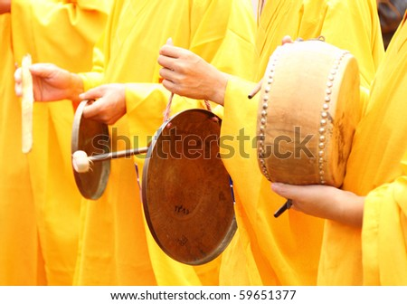 Buddhist monks drumming - stock photo