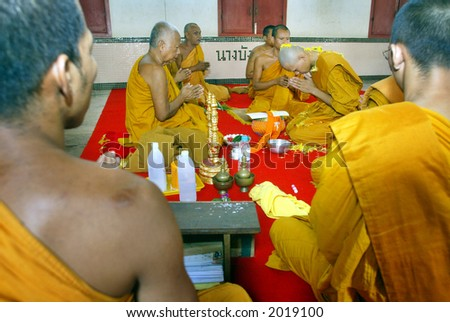Buddhist monks recite prayers at a temple, 2005. - stock photo