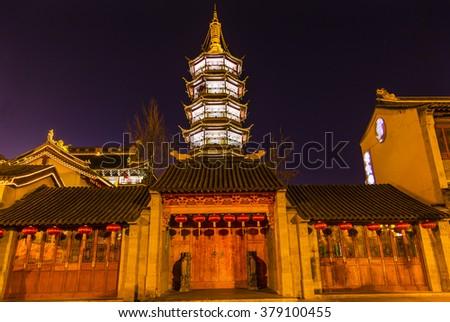 Buddhist Nanchang Nanchan Temple Wooden Door Pagoda Tower Wuxi Jiangsu Province, China.  Temple was established in approximately 550AD. - stock photo