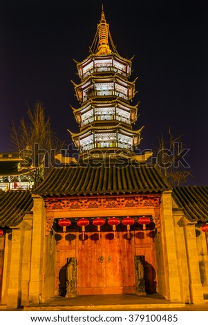Buddhist Nanchang Nanchan Temple Wooden Door Pagoda Tower Wuxi Jiangsu Province, China.  Temple was established in approximately 550AD. - stock photo