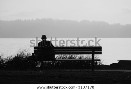 Buddhist on the bench overlooking water