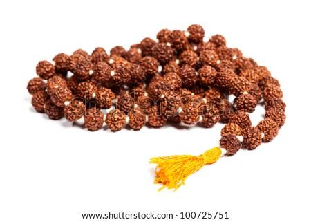 Buddhist or Hinduist Japa mala (prayer beads) made of rudraksha isolated - stock photo