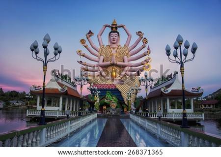 Buddhist pagoda at sunset. Temple complex Wat Plai Laem on Samui island. Thailand, Koh Samui - stock photo