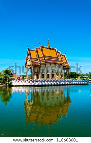 buddhist pagoda reflected in water in Koh Samui island, Thailand