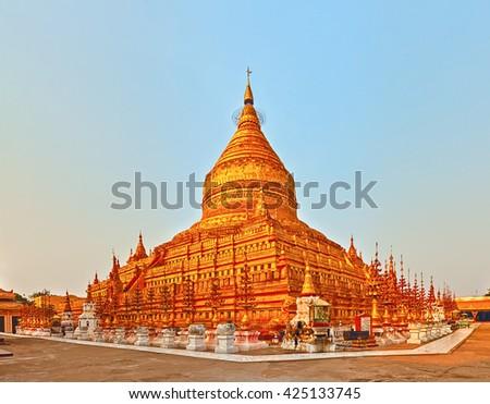 Buddhist pagoda Shwezigon in Bagan. Myanmar. Panorama - stock photo