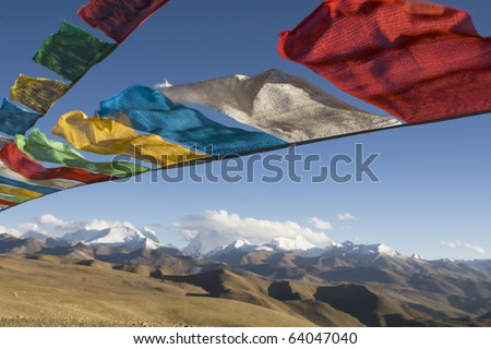 Buddhist prayer flags and The Himalayas - stock photo