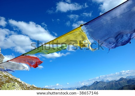 buddhist prayer flags blowing in the wind - stock photo