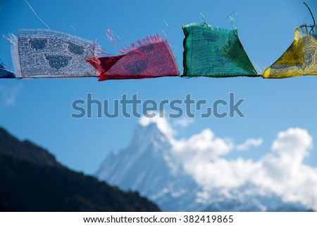 Buddhist prayer flags in the Himalaya mountains, Annapurna Base Camp Area, in Nepal - stock photo