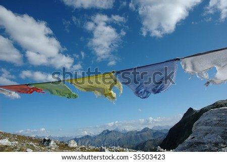 buddhist prayer flags in the wind - stock photo