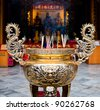 Buddhist prayer sticks in chinese temple - stock photo
