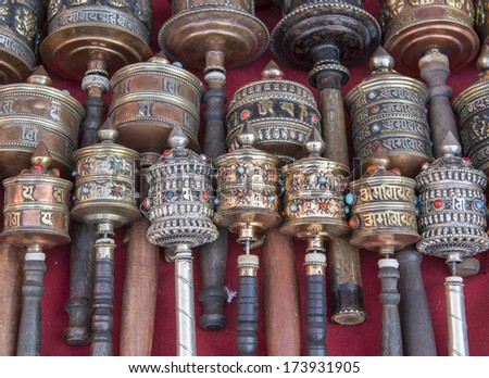 Buddhist prayer wheels for sale, Nepal  - stock photo