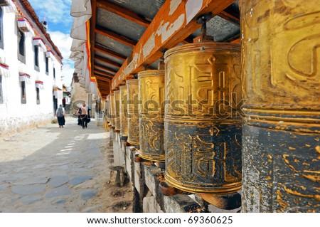 Buddhist prayer wheels in Tibetan monastery - stock photo