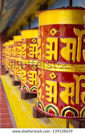 Buddhist prayer wheels, Nepal - stock photo