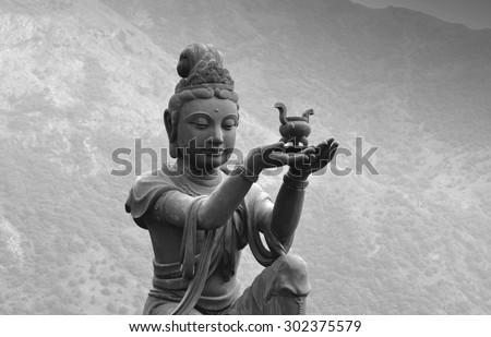 Buddhist statue at Po Lin Monastery - Lantau Island. Black and white variant. - stock photo