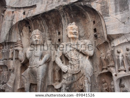 Buddhist statues in Longmen Grottoes. China (manual focus) - stock photo
