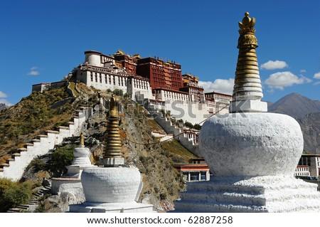 Buddhist stupa and Potala palace in Tibet - stock photo
