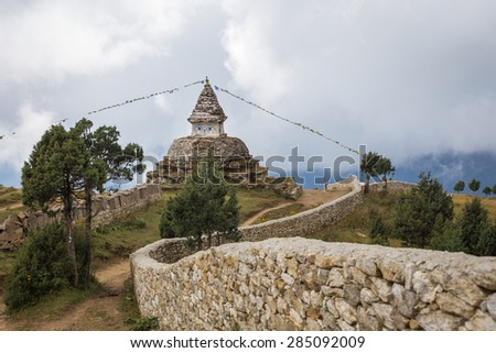 Buddhist stupa building high in Himalaya mountains clouds, Nepal. culture. - stock photo