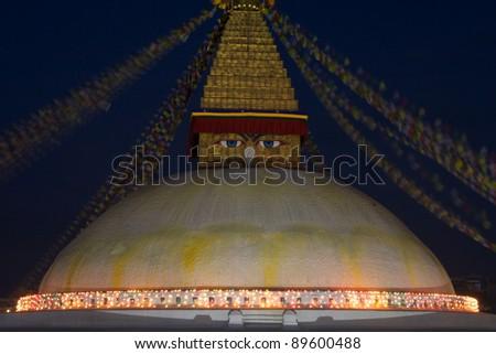 Buddhist stupa with illumination at night - stock photo