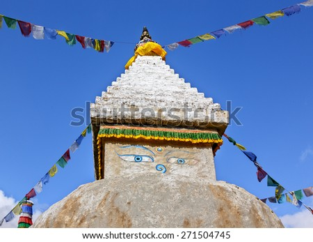 Buddhist stupa with ritual flags along the trail near Thame village - Everest region, Nepal, Himalayas - stock photo