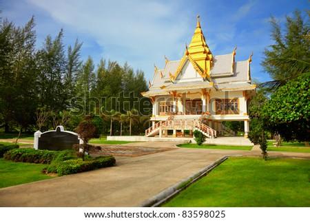 Buddhist temple among the tropical vegetation - Thailand, Phuket - stock photo