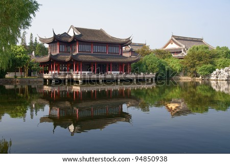 Buddhist temple and pond, ancient town Zhouzhuang, China - stock photo