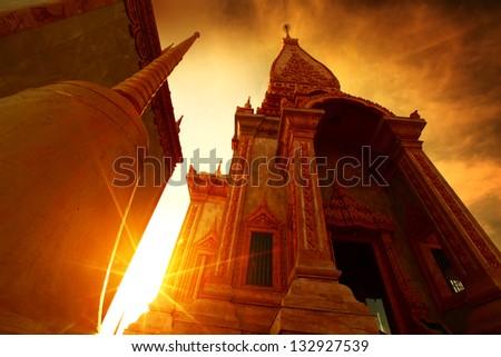 Buddhist temple at sunrise. Thailand - stock photo