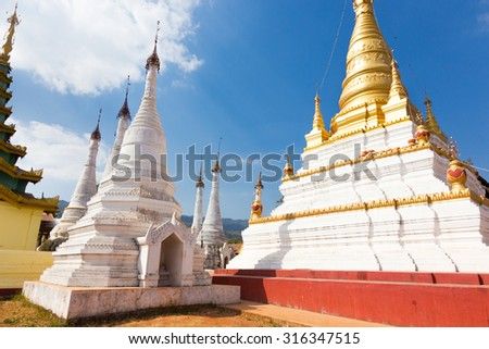 Buddhist temple close to Pindaya Cave located next to the town of Pindaya, Shan State, Burma, Myanmar,  Famous buddhist pilgrimage site and a tourist attraction. - stock photo