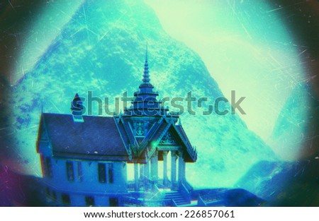 Buddhist temple in mountains -Wat Phra Phut or Wat Phra Lo - stock photo