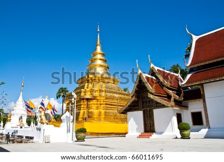 buddhist temple with blue sky - stock photo