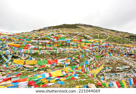 Buddhist tibetan prayer flags in tibet,china  - stock photo