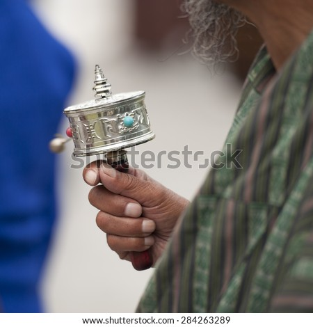 Buddhist worshipper at the National Memorial Chortan in Bhutan, Asia - stock photo