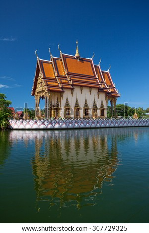 buddhistic pagoda reflected in water in Koh Samui island, Thailand