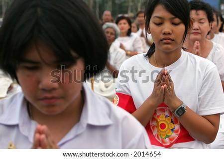 Buddhists reciting prayers, 2005. - stock photo