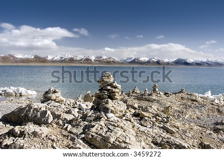 buddish mani stone piles at lake side