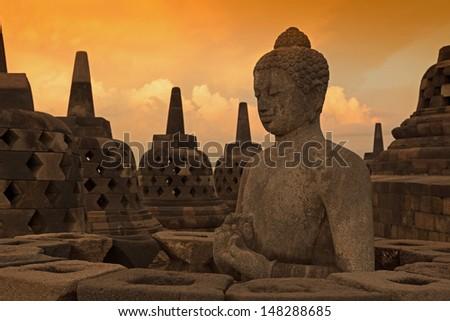 Buddist temple Borobudur at sunset. Yogyakarta. Java, Indonesia - stock photo
