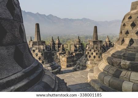 Buddist temple Borobudur on sunset background. Yogyakarta. Java, Indonesia - stock photo