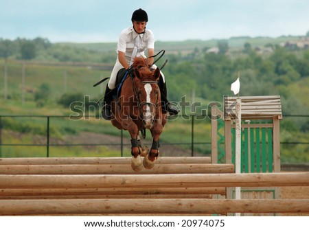 BUDESHTI - JUNE 15: Rider in the jumping show, stage of the Moldavian Jumping Championship , june 15, 2008 in Budeshti, Moldova.