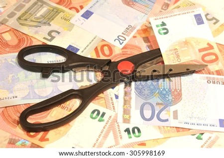 Budget cut concept with scissors and euros