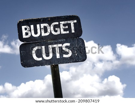 Budget Cuts sign with clouds and sky background  - stock photo