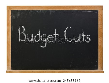 Budget cuts written in white chalk on a black wood framed chalkboard isolated on white - stock photo