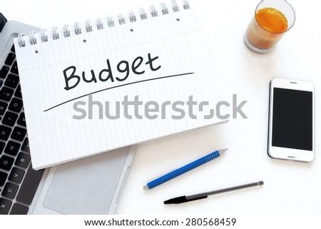 Budget - handwritten text in a notebook on a desk - 3d render illustration. - stock photo