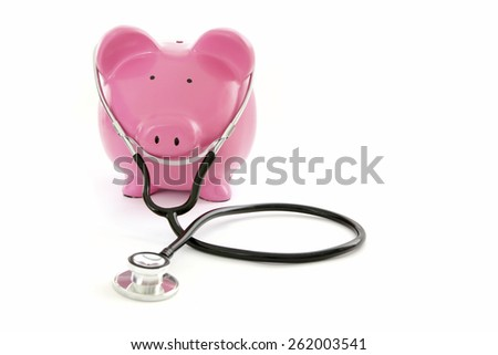 Budget Health Check - Piggy Bank on White Background with stethoscope  - stock photo