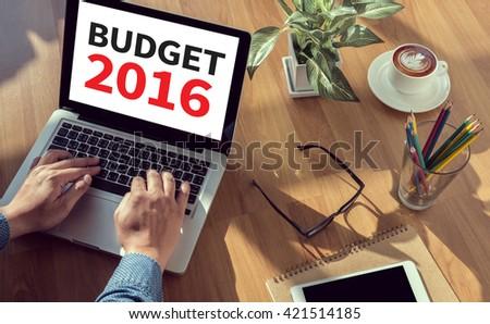 BUDGET 2016 man hand on table Business, coffee, Split tone - stock photo