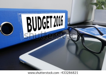 BUDGET 2016 Office folder on Desktop on table with Office Supplies. ipad - stock photo