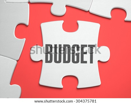 Budget - Text on Puzzle on the Place of Missing Pieces. Scarlett Background. Close-up. 3d Illustration. - stock photo