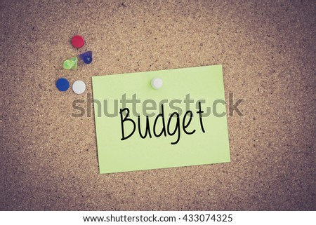 Budget written on sticky note pinned on pinboard - stock photo